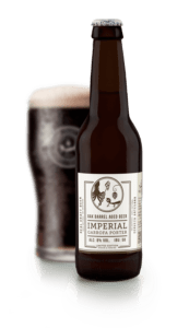 Imperial porter, cerveza negra, Garrofa, oak barrel aged beer. cervezas ibosim, ibosim craft beers, ibiza beer company, cerveza hecha en ibiza. craft beer made in ibiza. mar sol brewery microcerveceria, hippy life ibiza. cerveza de tirador. ibiza draft beer santa eulalia. port des torrent. mejor cerveza de ibiza